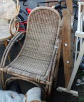A bentwood and wicker lounge chair - sold with a small folding stepladder