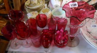 A selection of cranberry glassware including wine glasses, tumblers, jugs, etc. - various condition