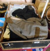 A box containing a quantity of textiles including damask and other tablecloths, tweed child's