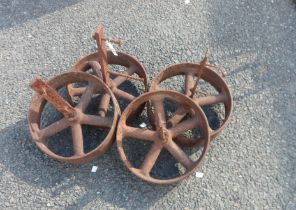 A set of four bolt-on iron wheels from a Norfolk chicken house