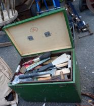 A painted box containing assorted painting and decorating tools including brushes, scrapers, etc.