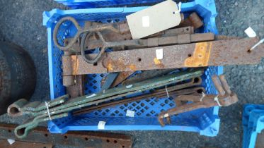 A crate of assorted iron hinges