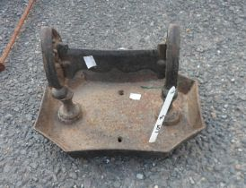 A painted iron boot scraper