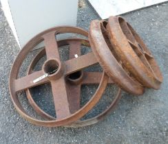 Two pairs of old iron barrow wheels