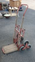 A red painted stair climbing sack barrow