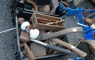 A crate containing assorted tools including axes, hand drills, auger bits, etc.