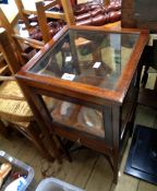 A 37cm early 20th Century stained mahogany free standing table vitrine with all round glazing,