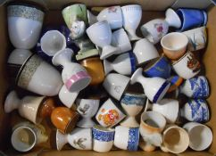 A box containing a quantity of vintage and other ceramic egg cups