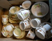A box containing a Royal Albert part tea set in the Flowers of the Month pattern and two other
