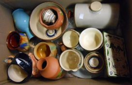 A box containing a quantity of Torquay pottery including Watcombe hair curlers stand, etc. - sold
