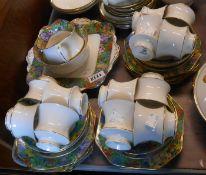 A Paragon bone china part tea set in the Springtime pattern comprising twelve trios, milk and