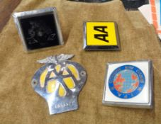 Four vintage car badges including two AA, one IPA, etc.