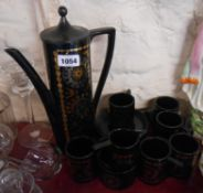 A vintage Portmeirion pottery coffee set in the Coptic Brocade pattern designed by Susan Williams