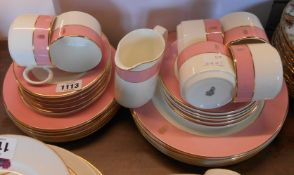 A quantity of Royal Doulton commercial tableware with pink banded decoration and gilt monogram H.G.