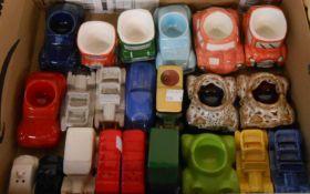 A box containing a quantity of ceramic novelty car items including egg cups, cruets, etc.