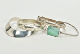 FOUR WHITE METAL BANGLES, to include two foliate engraved hinged bangles, each with an additional
