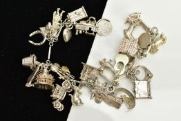 A WHITE METAL CHARM BRACELET, the bracelet of elongated links interspaced with circular links