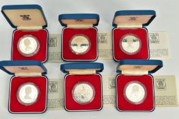 A SET OF SIX INDIVIDUALLY CASED 1952-1977 COMMEMORATIVE COINS, each with a design of the issuing