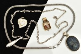 TWO WHITE METAL PENDANT NECKLACES AND TWO SEPARATE PENDANTS, the first designed with an oval black