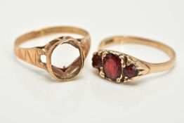 TWO 9CT GOLD RINGS, the first a graduated three stone oval cut garnet ring, within a scroll detailed