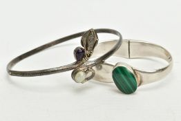 A SILVER MALACHITE SET BANGLE AND A WHITE METAL ARM CUFF, the hinged bangle set with an oval