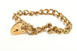 A 9CT GOLD HEAVY CHARM BRACELET, of curb link design hallmarked 9ct gold London import, fitted