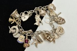A WHITE METAL CHARM BRACELET, suspending nineteen charms in forms such as a heart shaped jewellery