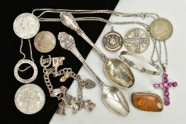 A SELECTION OF ITEMS, to include a silver teaspoon, with an engraved picture of Kirkstall abbey,