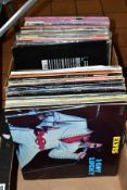 TWO TRAYS CONTAINING OVER EIGHTY LPs AND 12'' SINGLES including a number of Elvis repressings, a