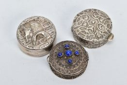 TWO EGYPTIAN SILVER PILL BOXES AND ONE OTHER, the first of circular form, scroll and floral detailed