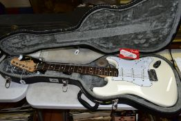 A 2008 MEXICAN FENDER STRATOCASTER Ser No MZ 8019434 in white with white scratch plate, pickup