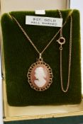 A 9CT GOLD CAMEO PENDANT AND CHAIN, the oval cameo depicting a lady in profile within a collet