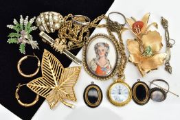 AN ASSORTMENT OF JEWELLERY, to include four brooches of various designs such as an oval miniature