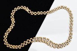 A TWO TONE GOLD GATE NECKLET, of yellow and white gold, fitted with an integrated box clasp