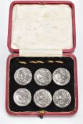 A CASED SET OF SIX EDWARDIAN SILVER BUTTONS, each one embossed depicting a lady in profile, with