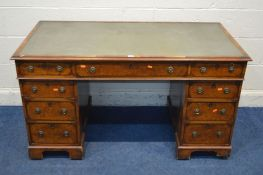 A REPRODUCTION WALNUT PEDESTAL DESK with nine various drawers width 136cm x depth 70cm x height 75cm