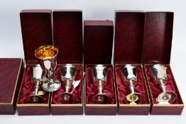 A SET OF SIX BOXED ELIZABETH II SILVER GOBLETS, gilt interiors, on conical stem to a circular