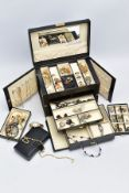 A LARGE LEATHER JEWELLERY BOX containing a large amount of silver and mostly costume jewellery,
