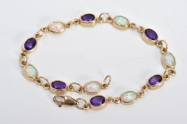 A 9CT GOLD LINE BRACELET, designed with twelve oval links set with six oval cut amethyst and six