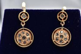 A PAIR OF YELLOW METAL DIAMOND DROP EARRINGS, each designed with a circular drop set with seven rose