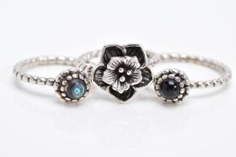 THREE WHITE METAL RINGS, the first of a daffodil design with beaded shank stamped 925, ring size