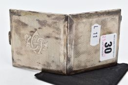 A SILVER COMPACT, square compact of an engine turn design, engraved monogram to the front, opens