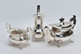 A GEORGE V THREE PIECE SILVER TEA SERVICE SET, to include a teapot and coffee pot each with a