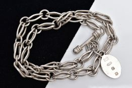 A WHITE METAL CHAIN WITH A SILVER FOB, the chain fitted with fancy openwork links fitted with a T-