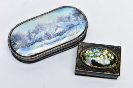 TWO DECORATIVE WOODEN TRINKET BOXES, the first of an elongated oval form, decorated with a painted