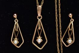 A YELLOW METAL, SEED PEARL PENDANT NECKLET AND MATCHING EARRINGS, of an openwork drop design