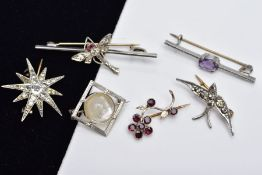 A COLLECTION OF SIX ASSORTED WHITE METAL BROOCHES, to include an early 20th century paste set