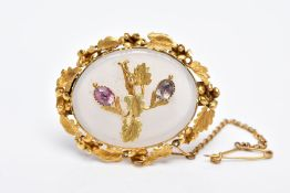 AN EARLY TO MID 20TH CENTURY YELLOW METAL GEM SET BROOCH, of an oval form, designed with a