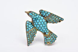 A VICTORIAN SILVER GILT TURQUOISE SET BROOCH, in the form of a bird set with red paste eyes and an