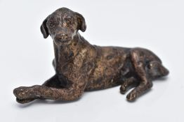 A SMALL BRONZED DOG, in a lying down position, approximate length 70.4mm
